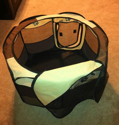 Portable pet playpen. Folding dog playpen.