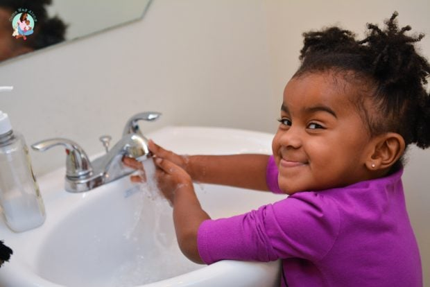 Toddler Washing Hands - Showing Independence Milestone